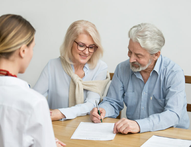 Aged couple signing lease